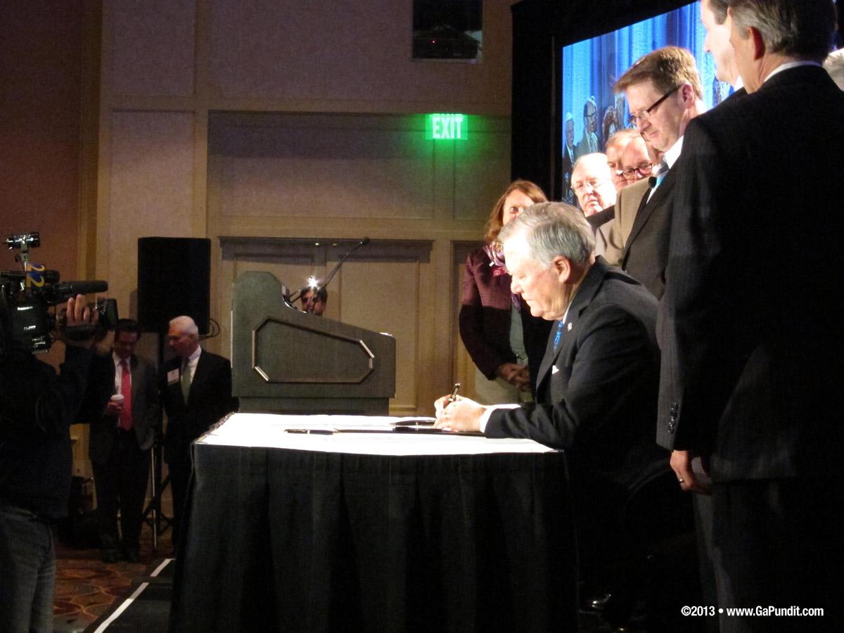 Deal Signing SB 24